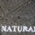 NATURAL painted on the sidewalk, Metropolitan and Bedford Aves, Wiliasmburg Brooklyn